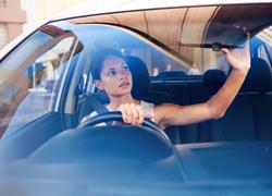 looking-in-car-mirror