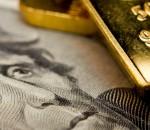 US dollar bill and gold bar 1200x627